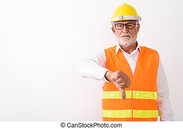 Studio shot of handsome senior bearded man construction worker g