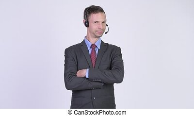 Studio shot of happy businessman as call center...