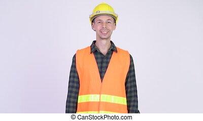 Studio shot of happy man construction worker smiling