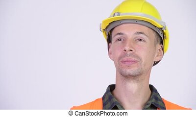 Studio shot of happy man construction worker thinking