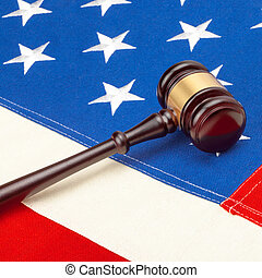 Studio shot of judge gavel over US flag - 1 to 1 ratio