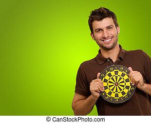 Studio Shot Of Man Holding Bullseye