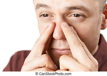 Studio Shot Of Man Suffering With Sinus Problem