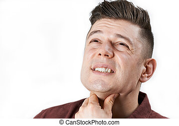 Studio Shot Of Man Suffering With Sore Throat