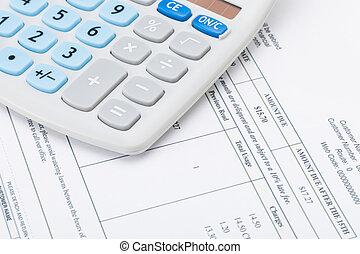 Studio shot of receipt next to calculator