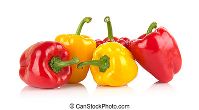 Studio shot of red and yellow bell peppers isolated on white