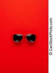 studio shot of red sunglasses. summer is coming concept....