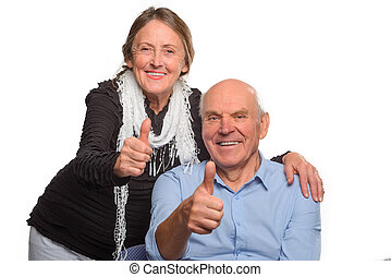 Studio shot of retired people. Granny and grandpa show OK
