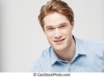 Studio shot of smart young guy - Handsome young man looking...