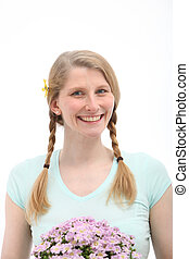 Studio shot of smiling blonde with pink flowers