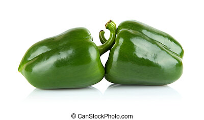 Studio shot of two green bell peppers isolated on white