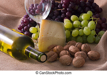 studio shot of wine, cheese and nuts