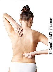 Studio Shot Of Woman With Painful Back From Behind