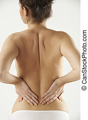 Studio Shot Of Woman With Painful Back