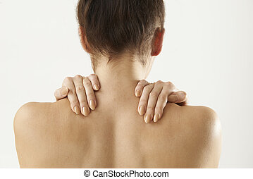 Studio Shot Of Woman With Painful Neck