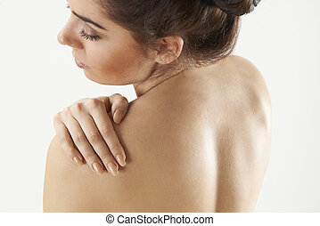 Studio Shot Of Woman With Painful Shoulder