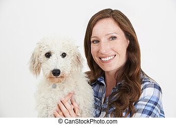 Studio Shot Of Woman With Pet Lurcher Dog