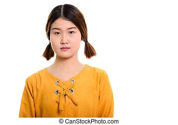 Studio shot of young beautiful Asian woman