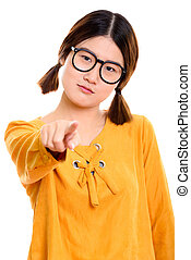 Studio shot of young beautiful Asian woman pointing finger at ca
