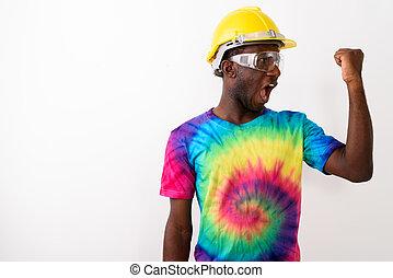 Studio shot of young black African man construction worker weari
