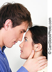 studio shot of young couple in love