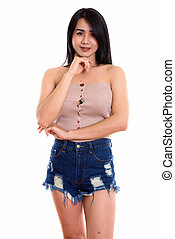 Studio shot of young happy Asian transgender woman smiling while