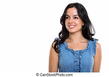 Studio shot of young happy beautiful Spanish woman smiling while