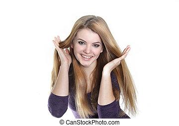 studio shot of young smiling woman