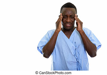 Studio shot of young stressed black African man patient having h