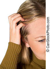 Studio Shot Of Young Woman Itching Scalp