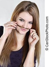 studio shot of young woman with hair moustaches