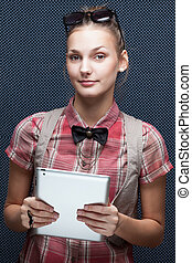Studio shot of young woman with tablet PC