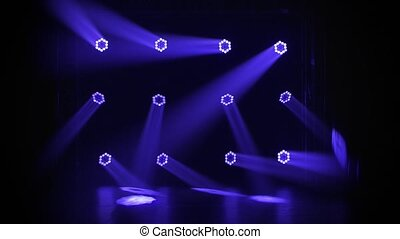 Studio spotlight or projector motion template. Dynamic blue light rays or beams blinking. Dark background. Lighting equipment. Shot for advertising, holiday or show