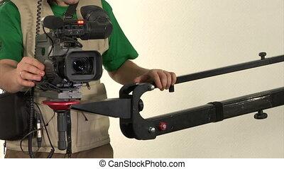 studio video shooting - cameraman finished shooting in...