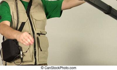 studio video shooting - cameraman shooting in studio with...