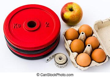studio vuurde, van, gewicht, platen, eitjes, een, appel, en, een, het meten van band, op, een, witte , achtergrond., symbolen, van, fitness, en, gezonde , voeding