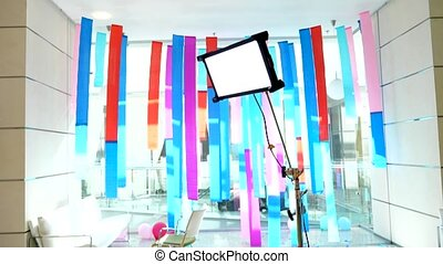 Studio with bright ribbons and light - Artificial light on...