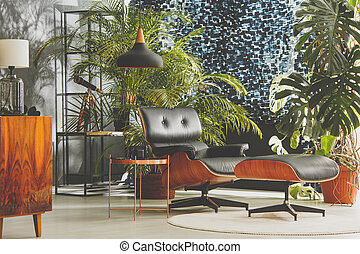 Studio with vintage furniture and exotic plants