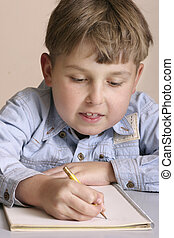Studious boy - Child doing homework or schoolwork