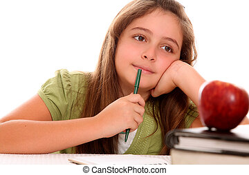 Studious girl thinking with his books and an apple on your...