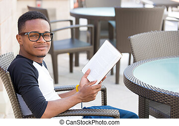 Studious guy - Closeup portrait, smart young nerdy man with...