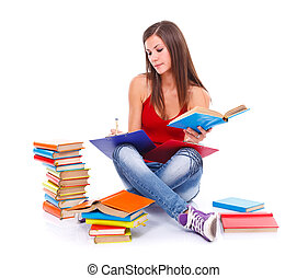 Studious woman - Young student woman sitting on the floor...