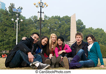 Study abroad student - Group of diverse students on campus