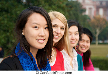 Study abroad students - Female college students outdoor in...