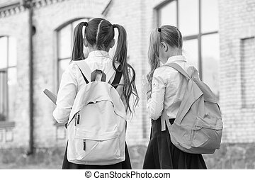 Study and spread knowledge. Little children carry heavy backpacks. Knowledge day. Back to school. Education and study. Knowledge skills. Private teaching. September 1. School time. Knowledge matters.