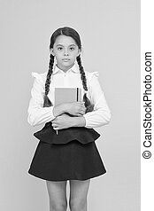 Study foreign language. Essay for homework. KId girl student likes to study. Study literature. Private lesson. Adorable child schoolgirl hold copybook. Formal education. School club after classes