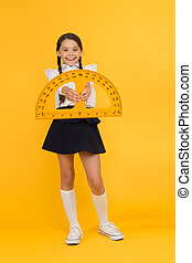 study hard. student use protractor ruler. stem class. Math science. back to school. Mathematics education. Kid in uniform on yellow background. happy small school girl study geometry