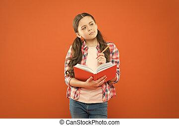 Study language. Child doing homework writing in workbook. ...