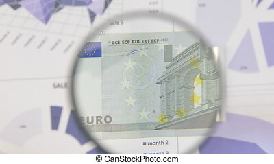 Study of a banknote five euro, increasing with the help of a...