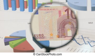 Study of a banknote ten euro, increasing with the help of a...